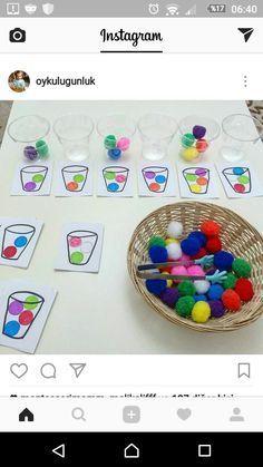 farbige Pompom-Bälle mit Zange nach Vorlage in Gläser sortieren