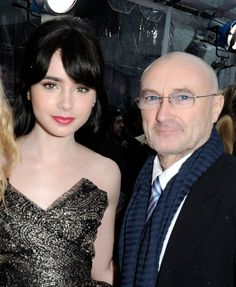 Lily Collins and her father, Phil Collins, at the 'Mirror, Mirror' premiere.