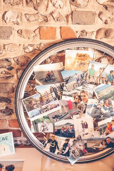 Polaroid pictures displayed in wheel spokes - Image by Story & Colour - Bride in Tea Length Lace Justin Alexander Dress with birdcage veil & Rachel Simpson Shoes. Bridesmaid in Hobbs navy dress for a rustic barn wedding with berry blooms, naked cake & nautical theme.