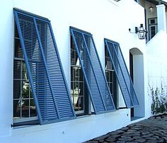 Gulf Coast Shutter is a Quality Provider of Storm Protection: Decorative & Impact Shutters, Windows, Doors, Garage Doors & Commercial Doors. Bermuda Shutters, Bahama Shutters, Blue Shutters, Beach House Bedroom, Beach House Decor, Home Styles Exterior, Interior And Exterior, Window Shutters Exterior, Hurricane Shutters