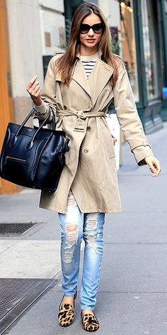 Miranda Kerr in beaten up jeans with a nautical stripe shirt, classic trench, structured bag and animal print loafers.
