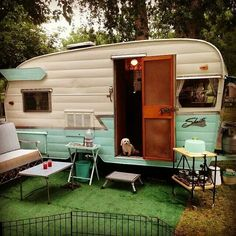 Turquoise and white vintage Shasta trailer.