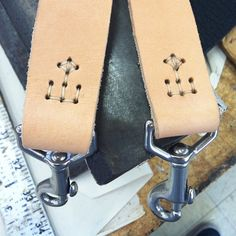 I thought these were razor strops but because they're in a pair, it's more likely they're suspenders/braces.