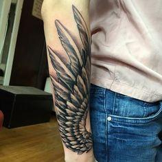 101901161303-angel-wings-tattoos