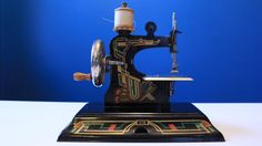 Vintage German Casige toy sewing machine with by MaterialCultures
