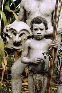 "A young boy of the Asaro ""Mudmen"" tribe in the highlands of Papua New Guinea waits to perform in the annual Garoka ""sing-sing. by Jodi Cobb"