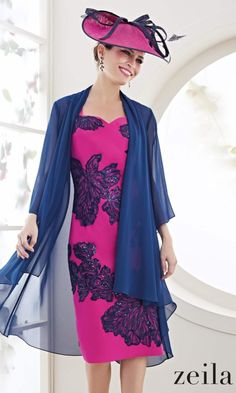Zeila Mother Of The Bride Dress & Floaty Jacket 3020636 Navy Fuchsia Fuchsia pink looks so amazing as a colour choice. Team it with navy and it is even more fabulous. This outfit by Zeila offers the best of both worlds when it comes to mother of the bride styles. You have the structure of the dress with the neat sleeves to cover your arms and the lace detail to make it special when you take the coat off. You have the floatiness and femininity of the lightweight frock coat which formalises…
