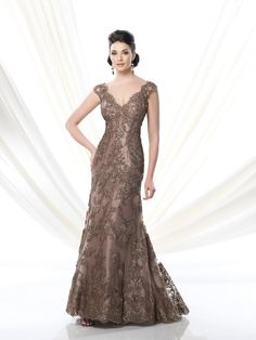Lace over taffeta fit and flare slim A-line dress with cap sleeves, scalloped front and back V-necklines, suitable for the mother of the bride or the mother of the groom. Matching shawl included. Embellish by David Tutera earring Taylor sold separately. Sizes: 4 – 20, 16W – 26W