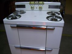 My new old 1940's Maytag Dutch Oven gas cookstove. I can't wait to move it in! The knobs at the center back move up and down to control the flame.  Maintenance and Repair Manual: http://oldstoveman.com/index1.html