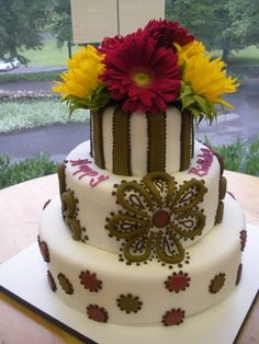 Vibrant yellow and pink colors mixed with real flowers on a birthday cake by Cake & All Things Yummy, Kernersville, NC