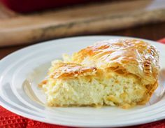 Greek Savory Cheese Pie - a traditional and very popular European treat. A cheese pie filling made with bechamel sauce, feta cheese, ricotta between 2 layers of puff pastry. Greek Cheese Pie, Cheese Pies, Cake Ingredients, Homemade Tacos, Homemade Taco Seasoning, Greek Recipes, Pie Recipes, Recipies, Gastronomia