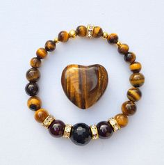 Tigers Eye, Garnet and Onyx bracelet for solar plexus activation and confidece by NakedFairyApothecary on Etsy