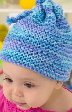 "Knit Garter Stitch Baby Hat- RHSS: 1 sk of Ocean, or color of choice Knitting Needles: 9/5.5mm  Hat circumference is 14"" GAUGE: 15 sts = 4"", 30 rows = 4"" in Garter stitch (knit every row). Squares = 7"" x 7"".   free pdf"