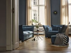 Mariposa 3-Seater | Mariposa Love Seat | Mariposa Ottoman | Hexagonal Table - The variously sized sofas of the Mariposa family are cosy and inviting, yet with a modern touch.