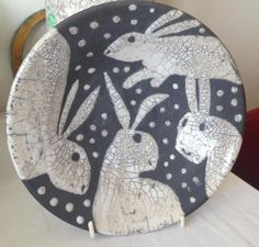 Josse Davies rabbit plate - this would be a good pattern for a hooked rug using strips of blue denim and old white t-shirts, sheets or pillow cases for the rabbits & snow flakes
