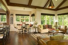 I love that the kitchen is open to the eating niche, and then to a large living room! And the beams and windows.