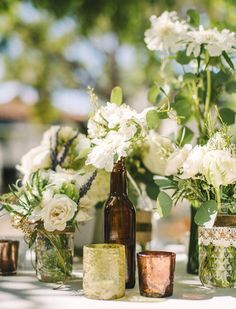 Neutrals like ivory, silver and beige look beautiful on a vintage tablescape with pastel accents or colored glass centerpieces. For a more glamorous feel, consider mixing and matching different heights of mercury glass candle votives.
