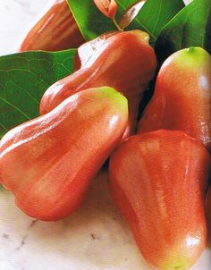 This is called a rose apple. What!?! It's an apple that looks like a pear and smells like a rose...