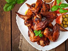 Tender chicken wings with a spicy kick! Serve with a side of ranch or blue cheese dressing to balance out the heat!