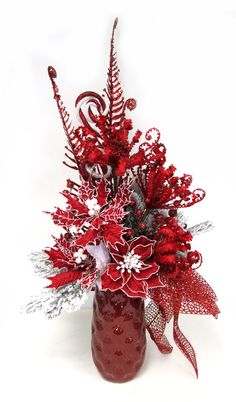 Red Poinsettia in red Vase