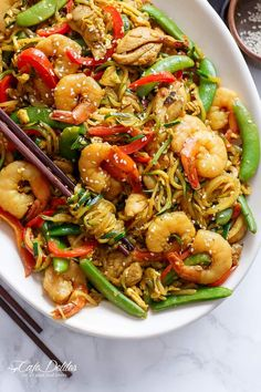 A twist on the classic Singapore Noodles only low carb and low calories! Singapore Zoodles will leave your house smelling like a Chinese restaurant!
