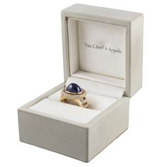 Van Cleef & Arpels Cabochon Sapphire Ring  | From a unique collection of vintage cluster rings at http://www.1stdibs.com/jewelry/rings/cluster-rings/