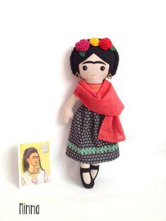 Handmade soft fabric doll, rag doll Frida Kahlo with black hair, pink shirt, floral print black skirt, red scarf and black flats.