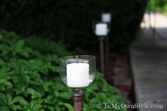 Walkway lights using empty water bottles and a dowel.  Directions and cute pics posted.