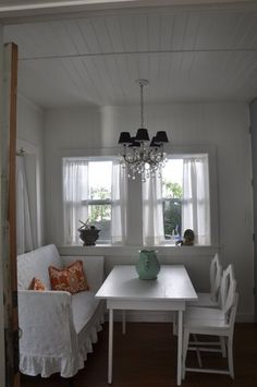 Beach Cottage Kitchen by Jane Coslick - I love the slipovered settee!