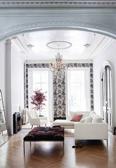elevated printed wallpaper paired with sophisticated furniture.