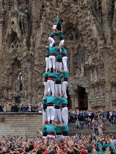 Human tower with the Sagrada Familia in the back..