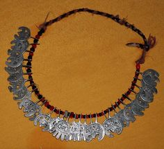 Libya | Small necklace; glass beads and silver horse shoe 'huafer' | ©Mustafa J Salem, on ethnic jewels