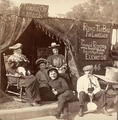 a picture from San Francisco taken shortly after the Great Earthquake and Fire in 1906. With most of the city destroyed, tent cities sprung up. Reading the signs, you can see that these folks lost everything . . . except their sense of humor.