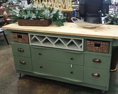 This dresser has been up cycled into this stylish kitchen island, drawers replaced by 2 trendy baskets, with a beautiful wood casters. Dresser Kitchen Island, Industrial Kitchen Island, Kitchen Island On Wheels, Rolling Kitchen Island, Farmhouse Kitchen Island, Kitchen Island Table, Kitchen Island With Seating, Kitchen Islands, Moveable Kitchen Island