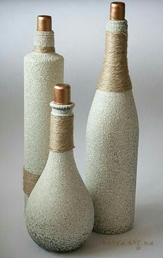 Looks like stone or textured spray paint and jute string #decoratedwinebottles
