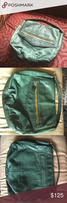 """🌞Green J.Crew Shoulder Bag! 🌞This great elegant bag is a rich forest green pebbled leather with chic zipper detail on the front. This bag has not been used & inside is flawless & tickets attached. Approx 16"""" X 13"""" with 4"""" drop. Because of how I stored it there are scruff marks on front when top lifted (not shown) and a mark on back & some blue marks along the piping as shown in pics. Very nice bag for work or play! J. Crew Bags Shoulder Bags"""