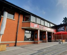 New Wolsey Theatre, Ipswich - 'The entrance has a large sweeping ramp to wheelchair users are not banished to a side entrance. The foyer is open with the box office at a good height. Access to the theatre is straight forward and the accessible seating is right by the doorway.'