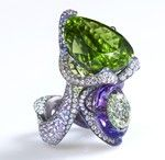 Nuwa ring by Wallace Chan shows off the jeweller's skills in combining the colours of a 45 ct peridot, amethyst and diamond.  Nüwa is a goddess in ancient Chinese mythology known for creating mankind and repairing the wall of heaven.  She sealed the broken sky using stones of seven different colors.