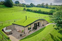 Nestled in the heart of the Welsh countryside this cosy retreat with a real grass roof is perfect for families looking for a fun staycation idea this year. The Burrow, Earth Homes, Log Burner, Staycation, Architecture, Wales, Countryside, Beautiful Homes, House Design