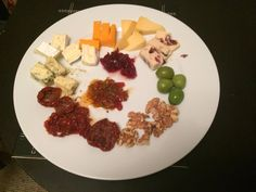 Five different types of cheese from Tesco's Cheese Selection, olives, walnuts, sundried tomatoes, spiced Moroccan chutney and cranberry sauce.