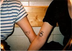 cup of coffee tattoo and a paper airplane tattoo. random but cute