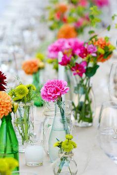 simple flowers in jars and bottles