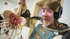 MythBuster Adam Savage Attends San Diego Comic-Con in a Homemade 'Alien' Spacesuit With Added Facehugger