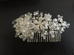The comb feautures ivory pearl, glass bead and rhinestone. Please let me know your wedding date also, so the packages arrive in time. All hair accessories are shipped within 1-3 business days. Please read mypolicies for delivery time.   Thank you for visit my shop!   ALL ORDERS WILL BE SHIP WİTH EXPRESS SHIPPING FOR US & CANADA & EUROPE 4-5 BUSINESS DAYS FOR US &CANADA 2-3 BUSINESS DAYS FOR EUROPE PLEASE DO NOT FOTGET TO WRITE YOUR PHONE NUMBER IN NOTE TO SELLER BOX