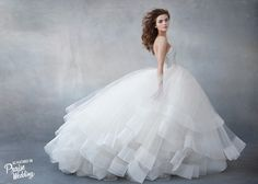 Champagne tulle ball gown featuring pearl and rhinestone encrusted bodice and romantic circular tulle skirt!