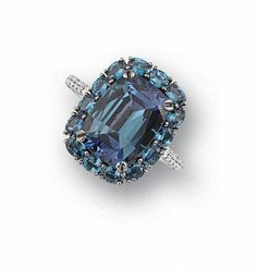 An alexandrite and diamond ring. Sold for $117,677 May 2008 auction. The cushion-shaped alexandrite, weighing 7.65 carats, within a four-claw setting, surrounded by oval mixed- cut alexandrites, to brilliant-cut diamond shoulders and gallery, mounted in platinum, ring size 5 ¾. FOOTNOTES Accompanied by a gemological report from the Gübelin Gem Lab, stating that the alexandrite is bluish-green colour in daylight, purple colour in incandescent light and transparent. The certificate also states tha