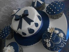 Detailed Royal Blue Cake and Cupcakes