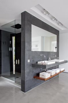 Very masculine style bathroom with interesting storage. A very clean, spacious, and uncluttered feel.