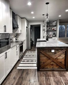 We are in LOVE with this modern farmhouse kitchen and how we could just stare at it all day long! The mix of dark and light woods with the grey and whites are to die for! Farmhouse Style Kitchen, Modern Farmhouse Kitchens, Kitchen Redo, Farmhouse Design, Home Decor Kitchen, Kitchen Styling, Cool Kitchens, Kitchen Remodel, Kitchen Design