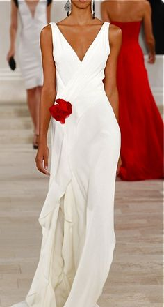 Long white v-neck dress with red flower at side below waist - stunning